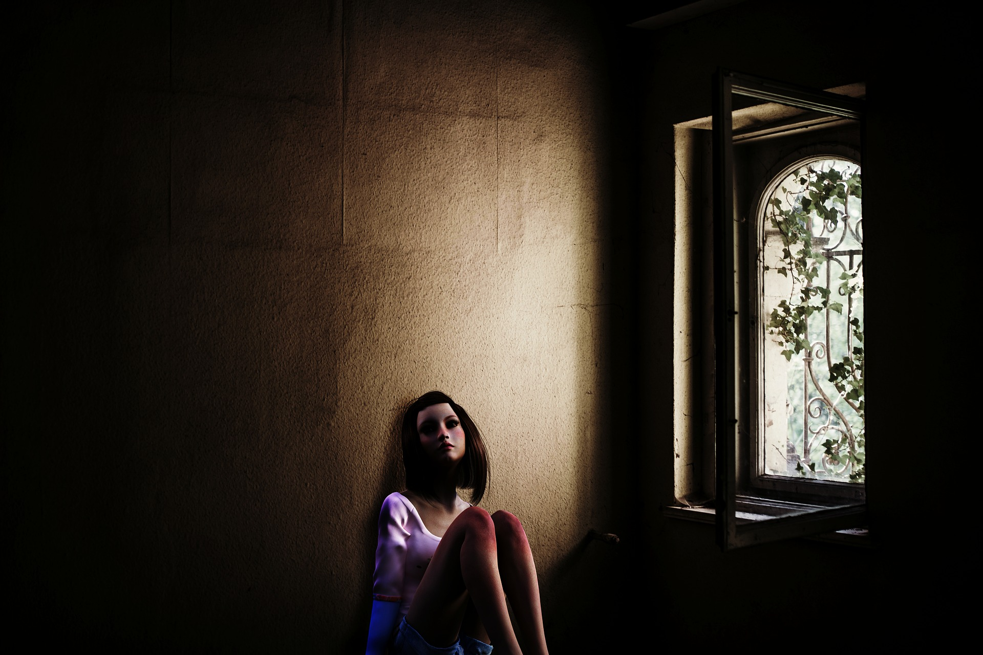 young woman in dark room looking anxious - anxiety